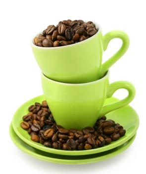 Green cups and coffee beans on white background (clipping path included)